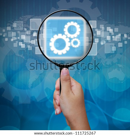 Gear icon in Magnifying glass ,business background