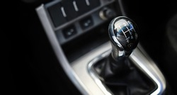 Gear lever. Manual Transmission. Hand on the gear shift in a car.