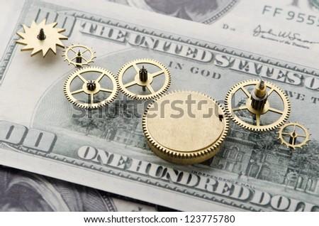Gear of success.Gear wheels on dollar bill revealing the path to success