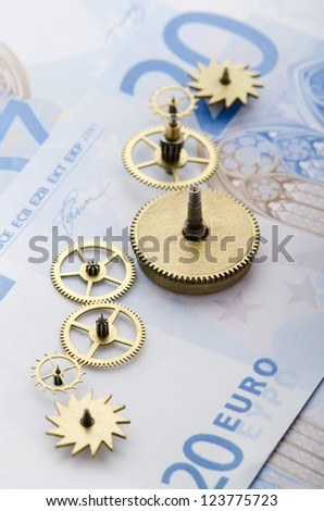 Gear of success. Gear wheels on Euro note revealing the path to success