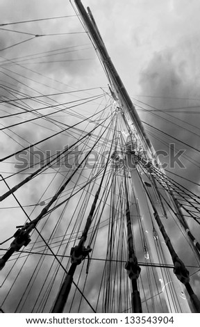 Gear old sailing ship on the background of an overcast sky - Turku, Finland (black and white)