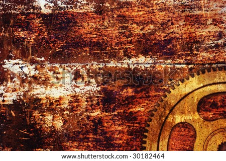Gear on rusty metal background