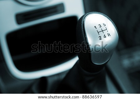 Gear shift handle in a modern car, closeup photo #88636597