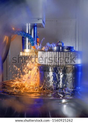 gear wheel is machined on a horizontal CNC machine center with  rotating tool and splashing coolant fluid