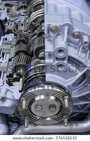 Gearbox cross-section, engine industry, sprockets, cogwheels and bearings of automotive transmission for oversize trucks, SUV, cargo, commercial and construction vehicles, selective focus  #376558531