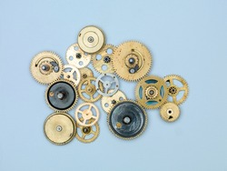 Gears and cogs macro, blue background. Top view. Vintage