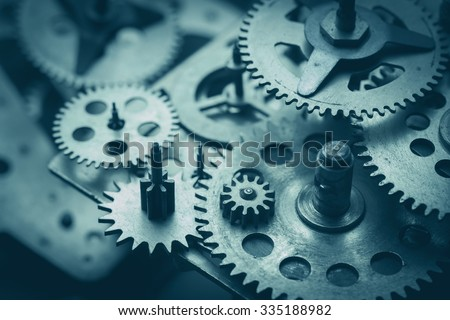Gears and cogs macro, blue toned