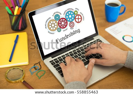 Gears and Fundraising Mechanism on Laptop Screen #558855463