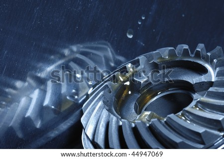 gears and oil concept, blue toning idea - stock photo