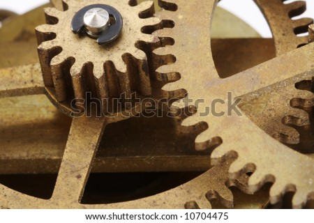 Gears from an antique clock in a close-up view.
