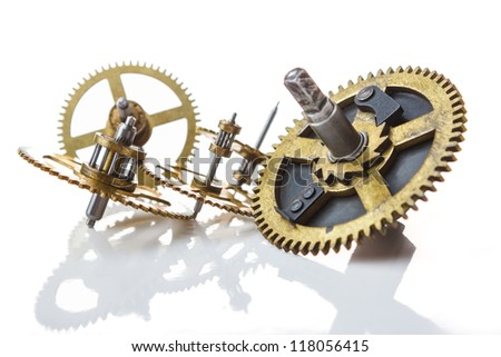gears from old clock isolated on white background with reflection