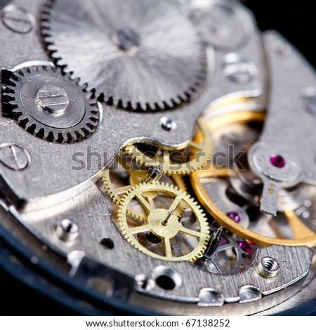 gears in disassembled wristwatch close up