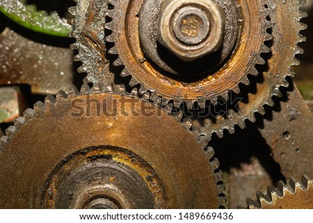 Gears of industrial machine. detail of mechanism. old cogwheels. mechanical parts of machinery