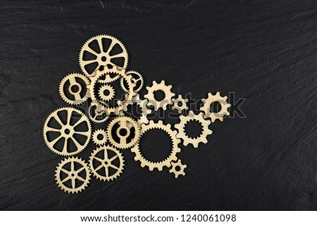 Gears on black background. Conceptual image of industry, mecanics, connection or team work.  #1240061098