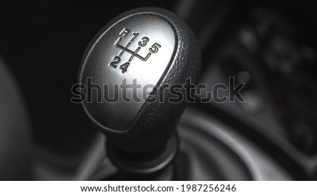 Gearstick transmission inside black interior car, close-up  Stock photo ©