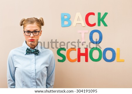 Geek girl is sad and angry because she has to go back to school.I don\'t want to go to school!