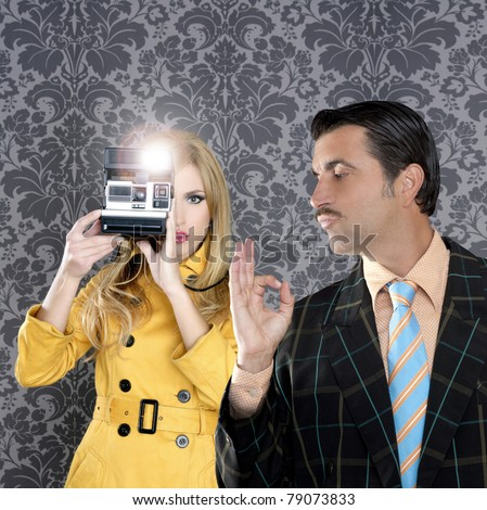 geek tacky mustache man reporter fashion girl photo shoot retro wallpaper [Photo Illustration]