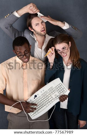Geeks with keyboard, salesman comb and pencil making faces
