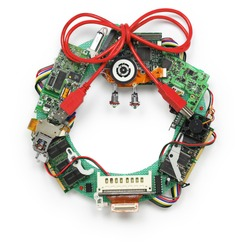 geeky christmas wreath made by old computer parts isolated on white background, christmas greeting card