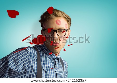 Geeky hipster covered in kisses against blue vignette background