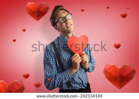 Geeky hipster covered in kisses against red vignette