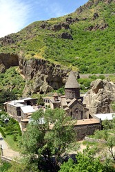 Geghard Monastery is an exceptional architectural construction partially carved into the rock of an adjacent mountain.