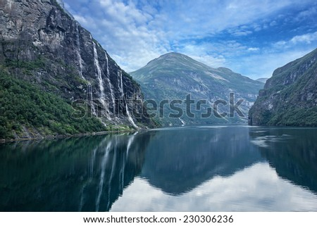 Geiranger fjord, Norway: landscape with mountains and waterfalls Seven Sisters.