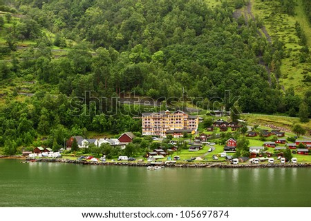 GEIRANGER - JUNE 26: Grande Fjord Hotel in small coastal village on JUNE 26, 2011 in Gieranger, Norway. Hotel located near Geiranger fjord, carried on UNESCO World Heritage List.