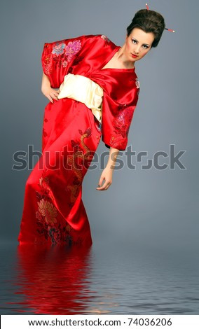 Geisha in red in water