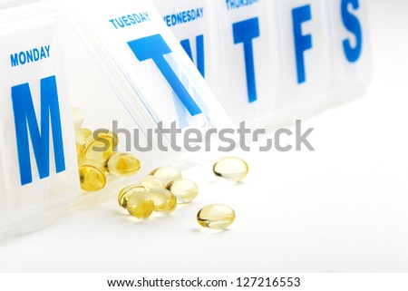 Gel vitamin supplement capsules with daily pill organizer box
