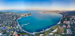 Gelendzhik resort at dawn-shooting from a quadrocopter. You can see the Gelendzhik Bay, the entire city, the sea pier, and a wide strip of beaches. In the center is the entrance to Gelendzhik Bay.