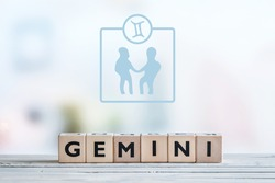 Gemini star sign on a wooden table