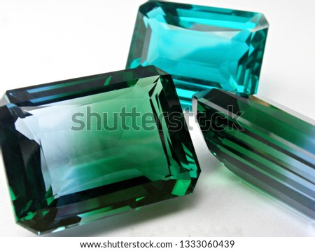gems stone sapphire emerald cut on white background for gems setting #1333060439