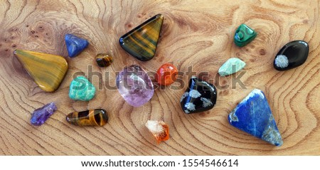 Gemstone Collection. A collection of semi precious stones on a wooden background.