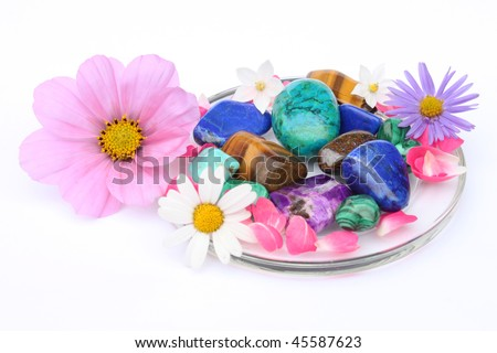 gemstones and flowers isolated on white background