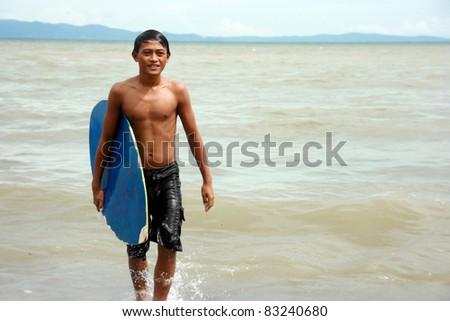 GEN. SANTOS CITY, PHILIPPINES - AUG 20: Michael  Zamora 17 years old prepare for the skim board competition at  Gen. Santos City, Philippines on Aug. 20, 2011. Held annually for the city festival.