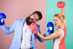 Gender battle. Gender equal rights. Gender equality. Man and woman boxing fight. Couple in love competing in boxing. Conflict concept. Family quarrel. Boxers fighting in gloves. Domination concept.