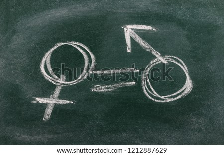 Gender equality concept drawn on chalkboard, blackboard background and texture