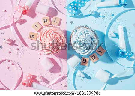 gender party. boy or girl. two cupcakes with blue and pink cream, celebration concept when the gender of the child becomes known Photo stock ©