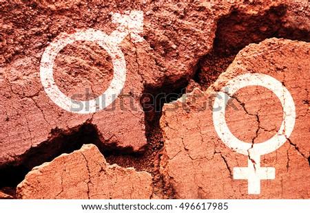 Gender symbols on earth background with a big crack, gender gap concept