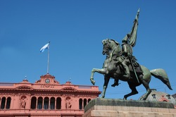 General Belgrano monument in front of Casa Rosada (pink house) Buenos Aires Argentina.La Casa Rosada is the official seat of the executive branch of the government of Argentina.