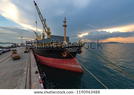 general bulk cargo ship staying for operation of loading and discharging cargo in sea port terminal