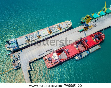 general bulk ships carrier are staying in midsea port terminal for transhipment the cargo services to shipper and transport to worldwide logistics system