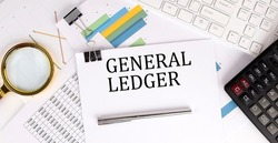 GENERAL LEDGER text on the white paper on light background with charts paper ,keyboard and calculator