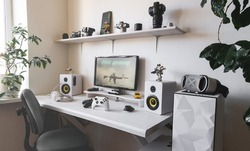General view home workplace of gamer with computer and gamepad.
