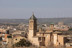 General view of the picturesque Ainzon skyline and surrounding rural landscape, with Our Lady of Mercy parish church, in the Campo de Borja region, Zaragoza, Aragon, Spain.