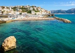 General view of the Prophet beach in Marseille, France, a very popular family beach located on the Kennedy corniche, on a hot and sunny spring day.