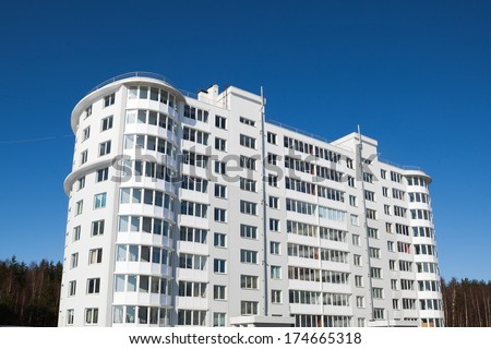 generic apartment house on blue sky background