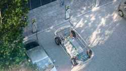 generic electric car with battery visible x-ray charging at public charger in city parking lot 3d render