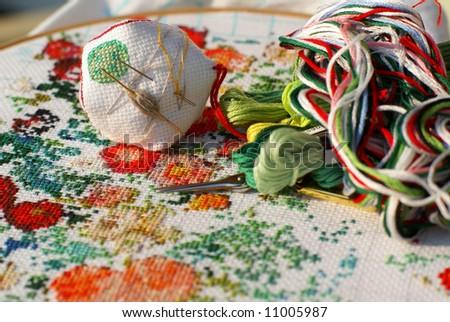 generic flowers on textile (cross stitch)
